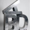 Lettres Metalvetica 100, Seletti r